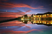 View over the Infinity Pool of the Peacock Garden resort in the evening, Baclayon, Bohol, Philippines, Asia