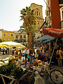 Street scene with flower stall, Calle Capuchinas, Granada, Andalucia, Spain