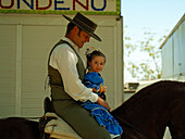 Rider with small girl in flamenco costume, Arcos de la Frontera, Andalucia, Spain