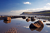 Beach scene with view towards Ravenscar, Robin Hood's Bay, Yorkshire, UK, England