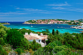 View of hillside town across bay, Porto Cervo, Sardinia, Italy