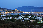 View over town and harbour to Castle of St Peter at night, Bodrum, Aegean, Turkey