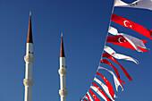 Minarets of mosque and flags, Turgutreis, Aegean, Turkey