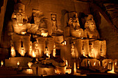 Floodlit statues in Temple of Ramses II at night, Abu Simbel, Egypt