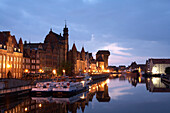 View along quayside at dusk, Motlawa River Inner Port, Gdansk, Poland