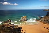 Beach scene with rocks in sea, Bedruthan Steps, Cornwall, UK, England