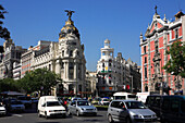 Gran Via, traffic and Metropolis building, Madrid, Spain