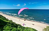 Beach scene with paraglider, Gdansk, near, Poland