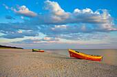 Beach scene with boats at sunset, Gdansk, near, Poland