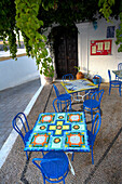 Outdoor cafe with blue tables and chairs, Lindos, Rhodes Island, Greek Islands