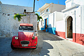 Red car in quiet village street, Koskinou, Rhodes Island, Greek Islands
