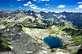 View over blue lake in Five Ponds Valley, Tatra Mountains, Poland