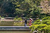 Wedding couple in Shukkeien garden, Hiroshima, Japan
