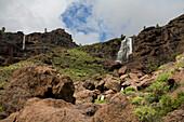 Waterfall under clouded sky, Los Azulejos, Barranco de Veneguera, Natural Preserve, Gran Canaria, Canary Islands, Spain, Europe