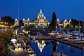 Victoria harbour and illuminated parliament at twilight in Victoria, Vancouver Island, Canada, North America