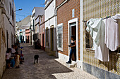 Women and children playing in the streets of Olhao, Algarve, Portugal