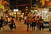 People and Akha women at the nightmarket, Chiang Mai, Thailand, Asia