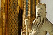 Chinese guardian figure in front of temple door at Wat Suwannaram, Thonburi, Bangkok, Thailand, Asia