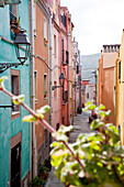 Colourful houses at a narrow alley at the Old Town, Bosa, Sardinia, Italy, Europe