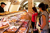 People at the counter at a delicatessen, Alghero, Sardinia, Italy, Europe