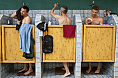 Three men in the shower at a camping site, Saxony, Germany, Europe