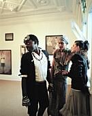 Fashion designer L. Jacobs, singer Sheba W. and singer from Ruanda at a vernissage, Peter Mc Leavey`s gallery, Cuba Street, Wellington, North Island, New Zealand