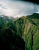 Aerial view of mountainside under clouds at Westland National Park, South Island, New Zealand