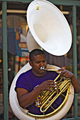 Man playing a sousaphone, a type of tuba, French Quarter, New Orleans, Louisiana, USA