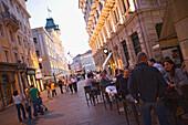 Evening on  Via del Teatro and the Piazza dell'Unita, The bar (right) is called Ex urbanis, Trieste, Friuli-Venezia Giulia, Upper Italy, Italy