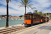 Nostalgic train Red Flash at the harbour Port de Sóller, Soller, Mallorca, Balearic Islands, Spain, Europe