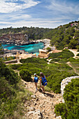 Mother and daughter hiking to the bay Cala s'Almonia, Mallorca, Balearic Islands, Mediterranean Sea, Spain, Europe