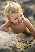Laughing little girl playing in the sand, Punta Conejo, Baja California Sur, Mexico, America