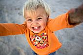 Portrait of a laughing little girl, Punta Conejo, Baja California Sur, Mexico, America