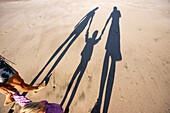 View at the shadow of a family in the sand, Punta Conejo, Baja California Sur, Mexico, America