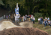 teenager jumps a backflip with dirt-bike, Dirt Park Starnberg, Bavaria, Germany