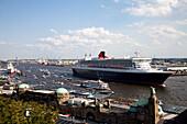 Queen Mary 2 passing St. Pauli Landing Bridges, Hamburg, Germany