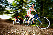Cyclist with child trailer, Lake Starnberg, Bavaria, Germany