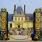 Gateway of Napoleon,  1rst railing and White Horse court with horseshoe staircase,  Château de Fontainebleau. Île-de-France,  France