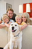 Adult, Adults, Animal, Animals, At home, Blond, Blonde, Blondes, Blonds, boy, boys, Brother, Brothers, Caucasian, Caucasians, child, children, Color, Colour, Contemporary, Couch, Couches, Dad, Dog, Dogs, Domestic animal, Domestic animals, Facing camera, F