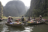 Floating Market, women in rowing boats on the Yen river, Ninh Binh Province, Vietnam, Asia