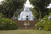 White Buddha Statue at a garden, Lam Dong Province, Vietnam, Asia