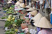 Vietnamese women at the market at Cai Rang, Mekong Delta, Can Tho Province, Vietnam, Asia