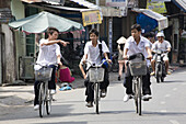 School boys on their bicycles at Can Tho, Mekong Delta, Can Tho Province, Vietnam, Asia