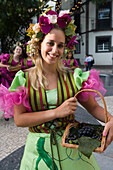 Young woman in colourful costume at the Madeira Wine Festival, Funchal, Madeira, Portugal