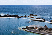 People enjoying a swim in the Natural Rock Pools, Porto Moniz, Madeira, Portugal
