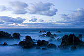 Lava rocks at dusk surrounded by sea water, Porto Moniz, Madeira, Portugal