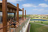 Two Women relaxing on the terrace of Porto Santo Golfe Golf Course Clubhouse, Porto Santo, near Madeira, Portugal