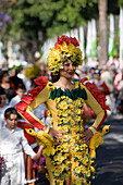 Woman in a floral costume at the Flower Festival Parade, Funchal, Madeira, Portugal