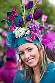 Young woman with flower headdress at the Madeira Flower Festival, Funchal, Madeira, Portugal