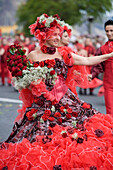 Woman with dress full of roses at the Madeira Flower Festival Parade, Funchal, Madeira, Portugal
